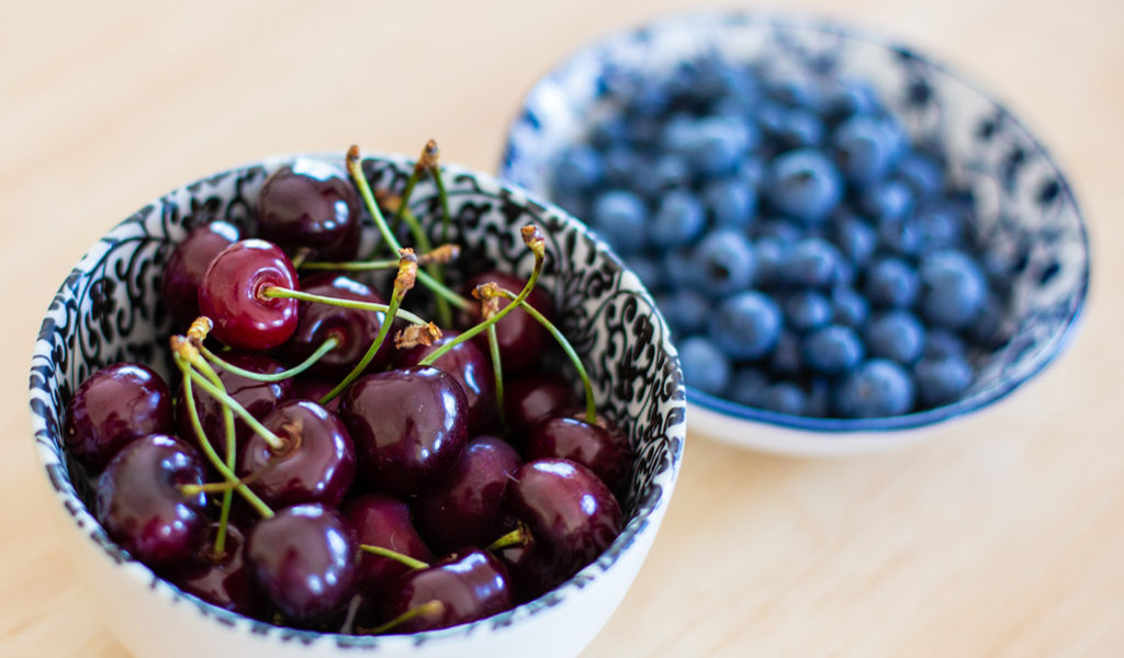 Bowls of cherries and blueberries